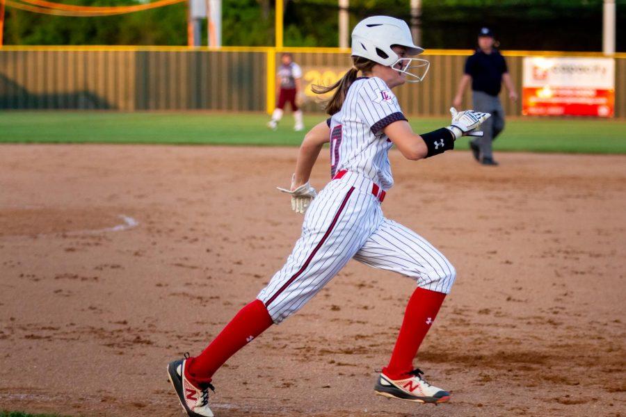 Freshman center fielder no. 10 Kamryn Messick runs to first base. Messick scored a run in the second inning.