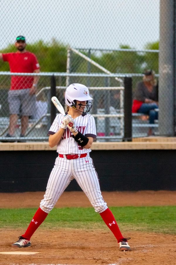 Sophomore catcher no. 3 Sydney Bardwell prepares to bat. Bardwell played as catcher during all four innings.