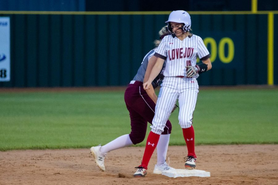 Junior outfielder no. 18 Bailey Bradshaw stops at second base. Bradshaw scored one run in the third inning.