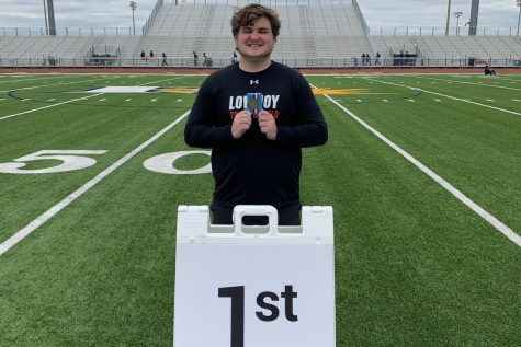 Senior Mason Stein holds his first-place medal after competing in the shot put event at the area track meet. Stein threw 51