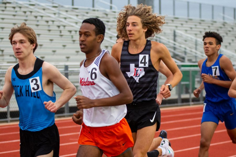 Junior runner Tate Barr runs in the 3200 meter race. Barr won this race, followed by Wakeland's Natnael Enright.