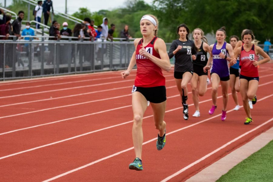 Freshmen runner Kailey Littlefield runs in the 800 meter race. Littlefield won this race by 8.25 seconds, followed by Independence's Brighton Mooney.