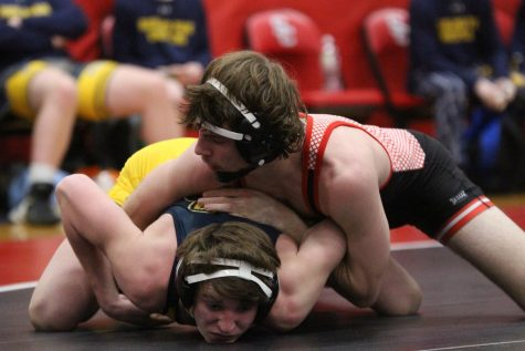 Senior wrestler Dalton Braun takes down his opponent. The wrestling team went to state this season, with one wrestler, senior Jakob Underwood, becoming a state champion.