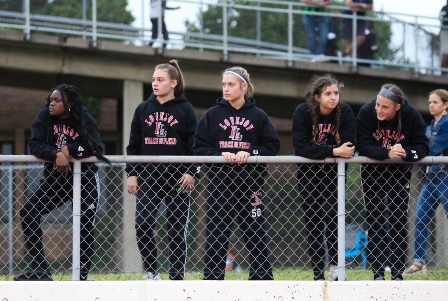 Sophomores Leila Ngapout, Chloe Schaeffer, Bella Landrum, Malia Bowling, and freshmen Lauren Dolberry watch the 1600 meter girls race. Sophomore Amy Morefield and freshmen Kailey Littlefield competed in this race.