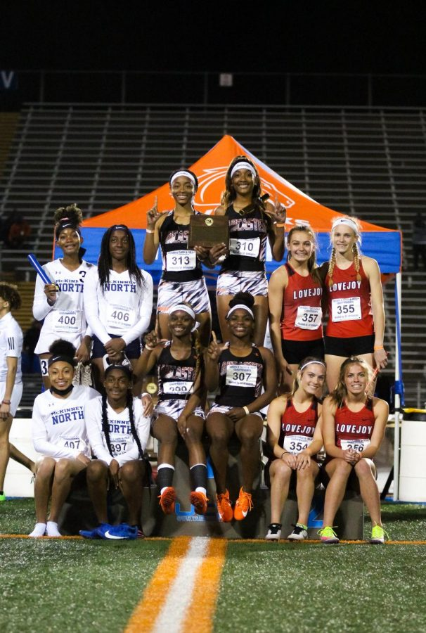 The top three teams from the girls 4x400 meter relay pose on the podium after racing. Lancaster placed in first, followed by the Leopards and McKinney North's teams.