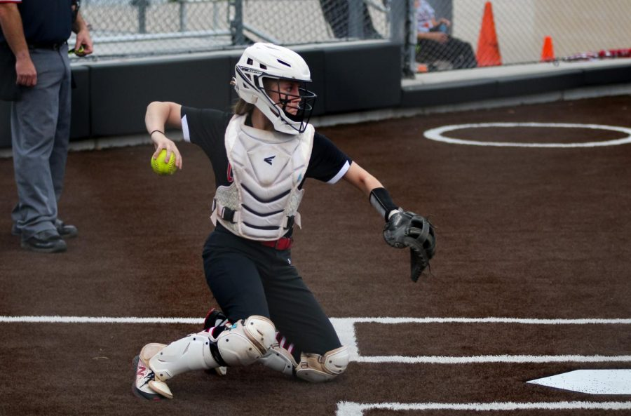 Sophomore catcher no. 3 Sydney Bardwell throws the ball back to sophomore pitcher no. 7 Jade Owens. The Leopards won this game with a score of 2-1.