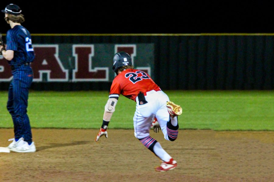 Freshman right fielder no. 23 Matthew Mainord dives into second on a double hit to left field line. Mainord reached base twice on one hit in the game.