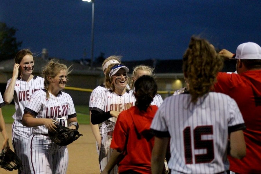 Junior third baseman no. 16 Emma Bittlestone and freshman shortstop no. 5 Skylar Rucker celebrate with the team after the fourth inning. The Leopards won with a final score of 9-4.