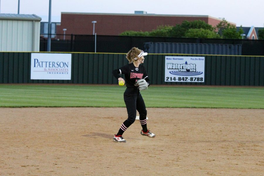 Freshmen short stop no. 5 Skylar Rucker throws the ball in an attempt to take a Denison runner. The Leopards stand first in district.