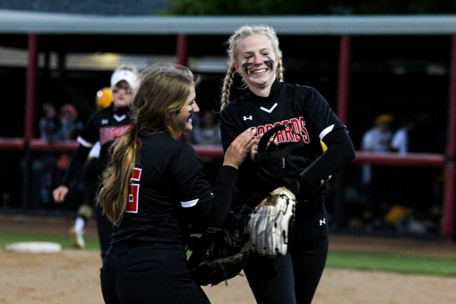 Junior third basemen no. 16 Emma Bittlestone and sophomore pitcher no. 7 Jade Owens celebrate as the Leopards gained a lead of 2-0. The team won the game with a score of 7-1.