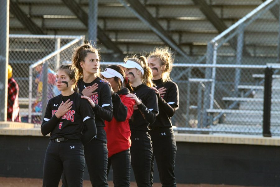 The Leopards stand for the national anthem. The Leopards played against Denison in a district game.