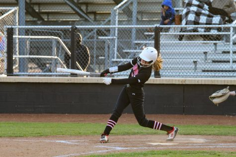 Freshman center fielder no. 10 Kamryn Messick swings in an attempt to hit. The Leopards lead the game with a score of one during Messick