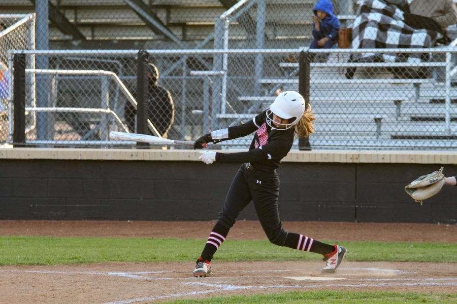 Freshman center fielder no. 10 Kamryn Messick swings in an attempt to hit. The Leopards lead the game with a score of one during Messick's hit.