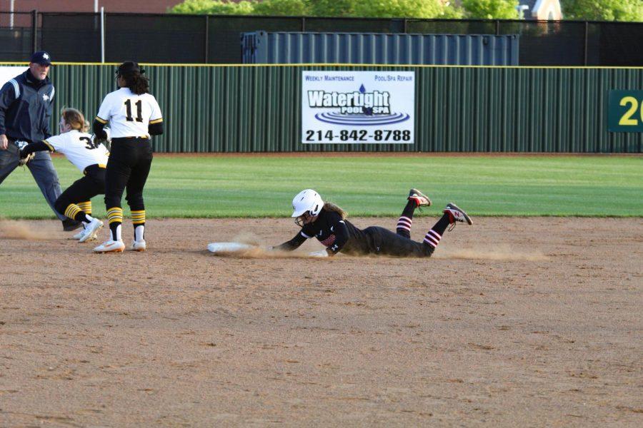 Sophomore second basemen no. 11 Hannah Harvey slides into second base. Harveys run was safe.