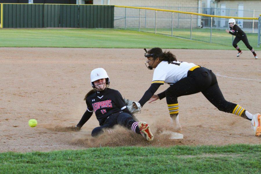 Sophomore center fielder no. 12 Elliott Pomeroy slides to third base. Pomeroys slide was safe.