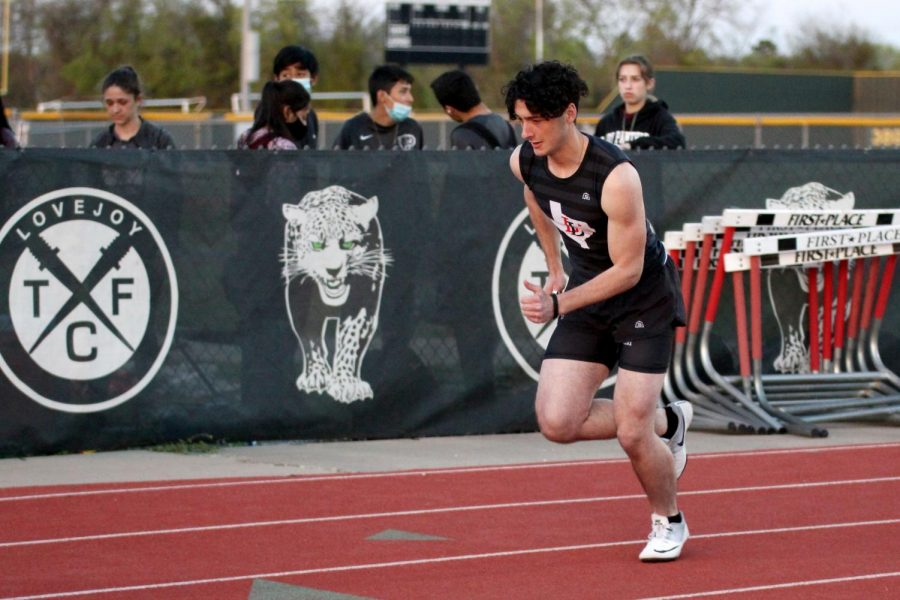 Senior relay runner Drew Pekinpaugh runs in the 4x100. The team finished the relay in 48.04 seconds.