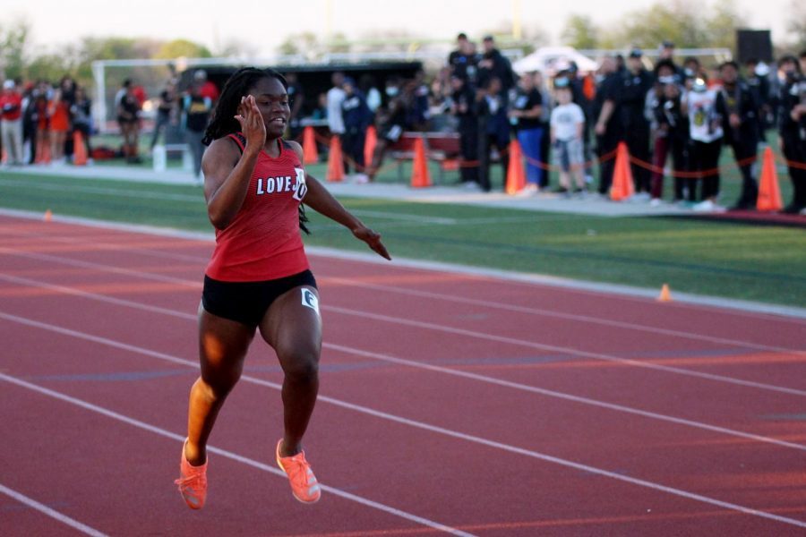 Sophomore sprinter Leila Ngapout runs in the 100 meter dash. Ngapout ran the race in 12.79 seconds.