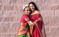 Junior Dinah Thadikonda and her mother Suma Joseph stands wearing a saree with her daughter Dina, who is wearing her kuchipidi dance costume. Joseph served in the Indian Navy and shared with Thadikonda lessons of trials she faced.
