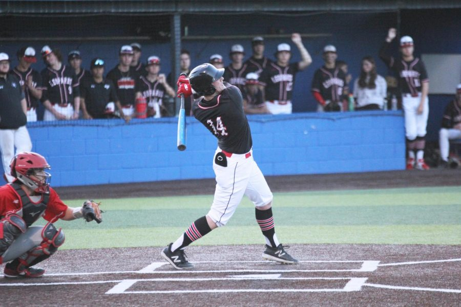 Senior catcher no. 14 Ralph Rucker hits the ball scoring a run for the Leopards. Rucker is a multisport athlete, also playing football.