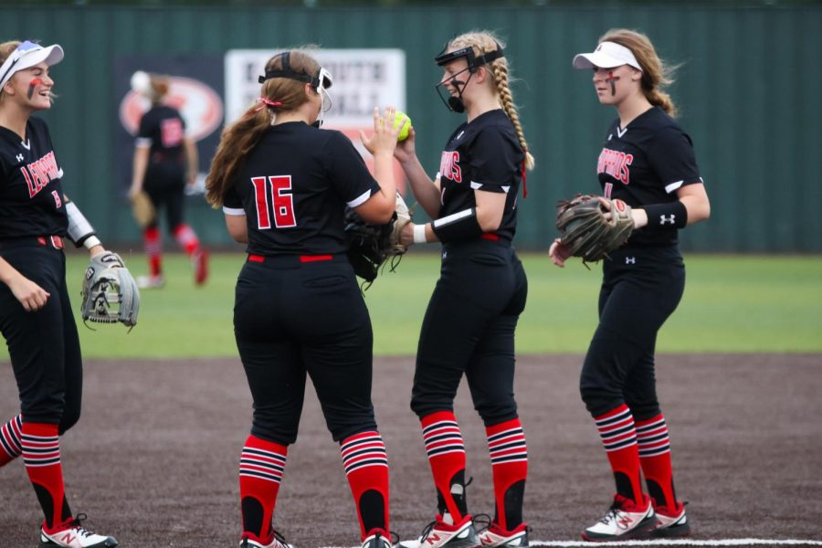 Junior third baseman no. 16 Emma Bittlestone high fives sophomore pitcher no. 7 Jade Owens after getting a player out. The team will plays Hallsville in the region finals.