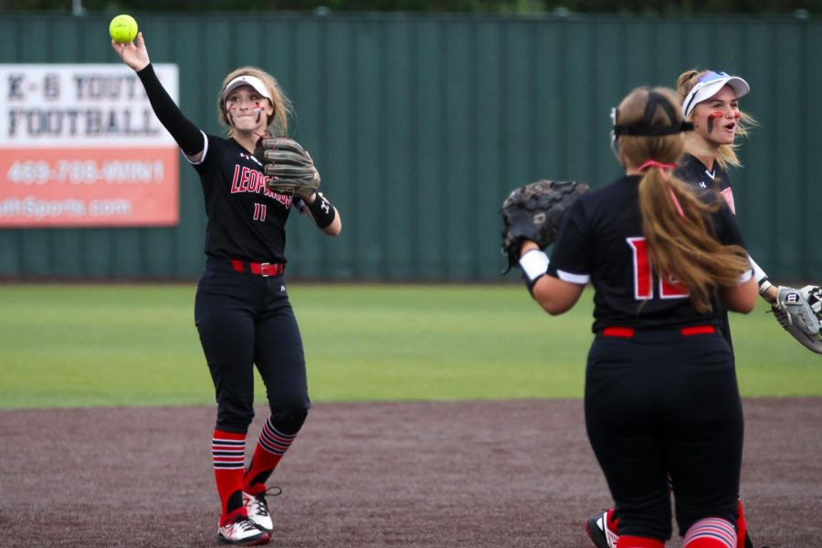Sophomore second baseman no. 11 Hannah Harvey thorws the ball to junior third baseman no. 16 Emma Bittlestone. The Leopards won the second game with a final score of 3-2.