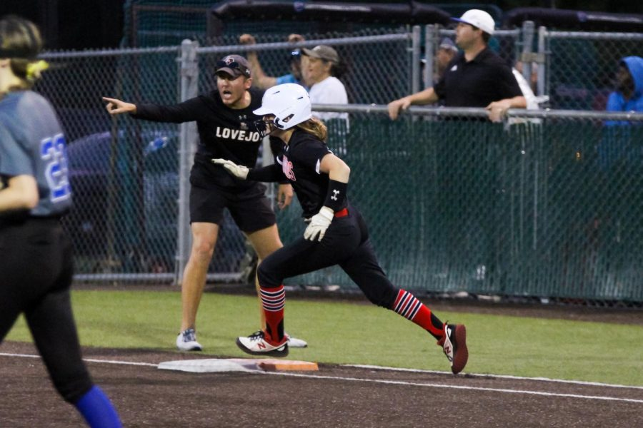 Freshman left fielder no. 10 Kamryn Messick runs past first base. The Leopards will play in Whitehouse tomorrow.