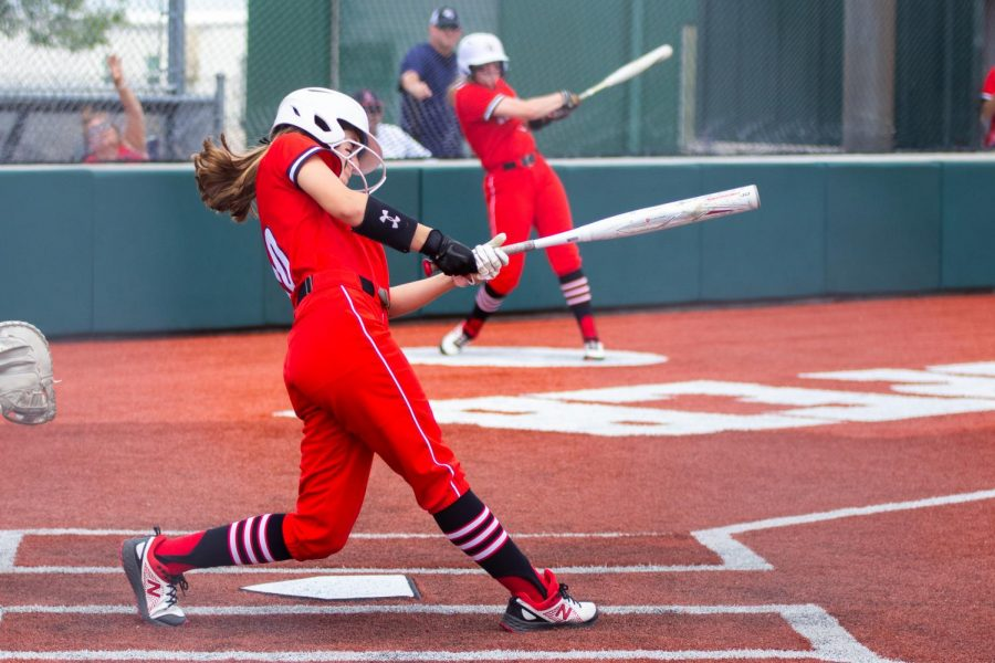 Freshman left fielder no. 10 Kamryn Messick swings to hit the ball. The Leopards won both of their area games against Creekview.