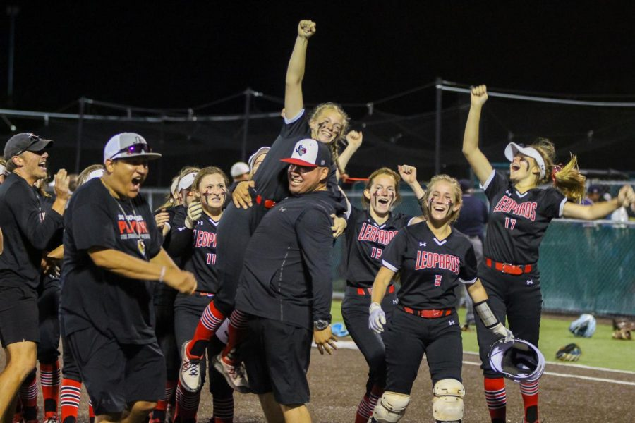 Coach DJ Lopez lifts up sophomore pitcher no. 7 Jade Owens after she scored the game winning run. The rest of the team cheered her on as this hit gave them the win to move on to the regional finals.