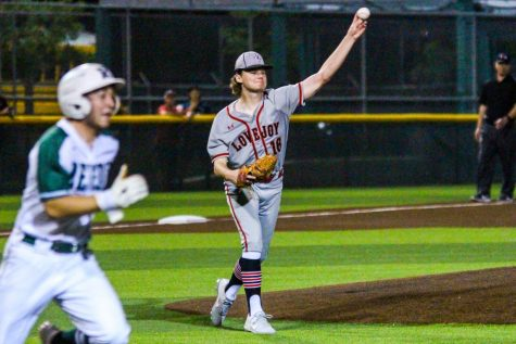 Junior pitcher no. 16 Brandt Corley throws over to sophomore first baseman no. 1 Sam Finn for an out of Reedy's batter. Corley only allowed two hits on the night.