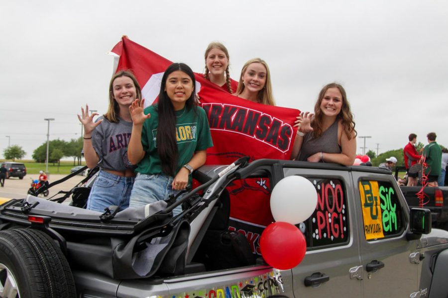 Seniors Taylor Schreiber, Kaley Nguyen, Avery Durham, Chloe Brown, and Abigail Smith hold up their school's hand signs. The group cheered together throughout middle and high school.
