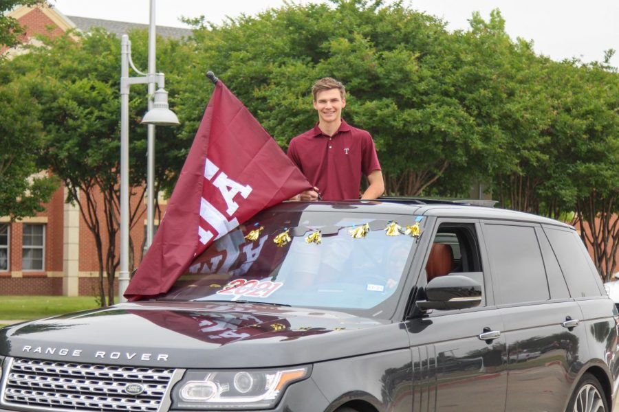 Senior Cade Coppinger carries an A&M flag. Coppinger will be attending the Unversity of Texas A&M in the fall.