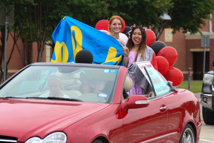 Seniors Taryn Sutherlin and Abigail Le ride together in the parade. Sutherlin will be attending UCLA in the fall.
