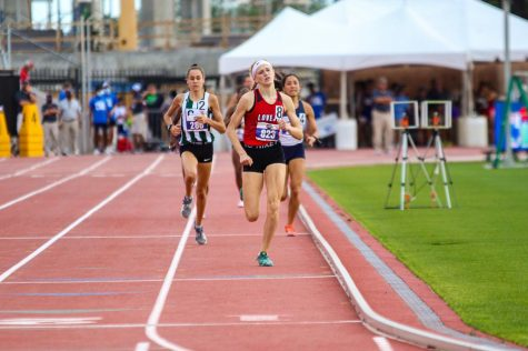 Freshman runner Kailey Littlefield reaches to cross the finish line of the 800 meter race on Friday. Littlefield's winning time of 2:08.04 minutes set both personal, school, and state records.