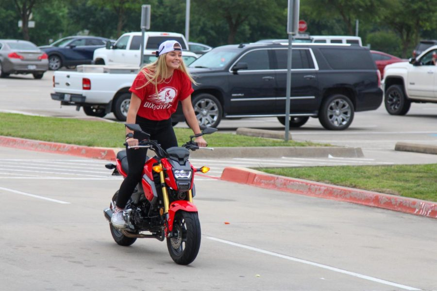 Senior Hailey Downing rides her bike for the parade. Downing is going to Utah to become a nail technician.