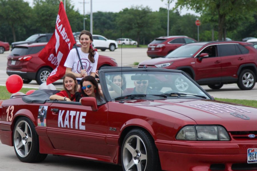 Senior Katie Dolberry rides in the back of a convertible with her family. Dolberry will be attending the University of Oklahoma to study sports broadcasting.