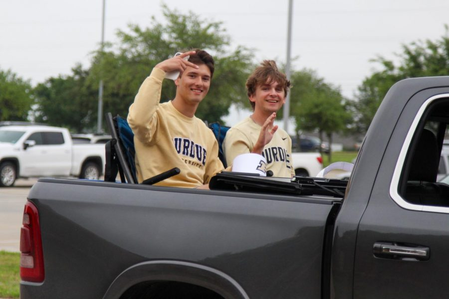 Seniors Josh Ringler and Stone Scalf ride together in the parade. Ringler and Scalf will both be attending Purdue University.