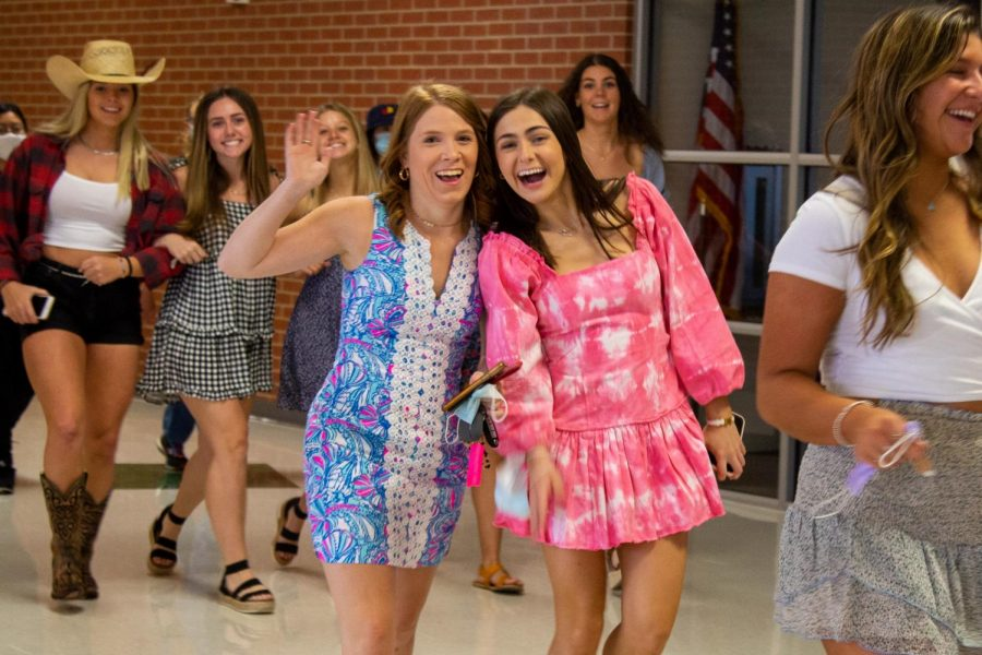 Seniors Katelyn Greenwood and Lily Melhorn walk through the school together. Melhorn will be attending the University of Texas in the fall.