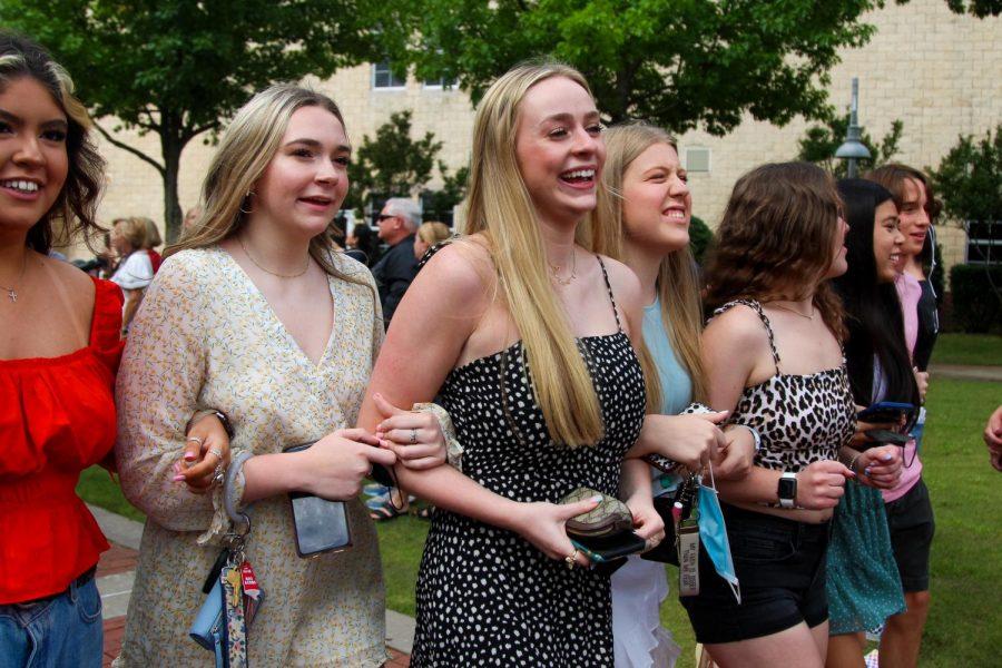 Senior Chloe Brown walks arm in arm with seniors Grace Baker, Avery Durham, Abigail Smith, Kaley Nguyen, and Blake Daehnert. Brown will be attending the University of Arkansas.