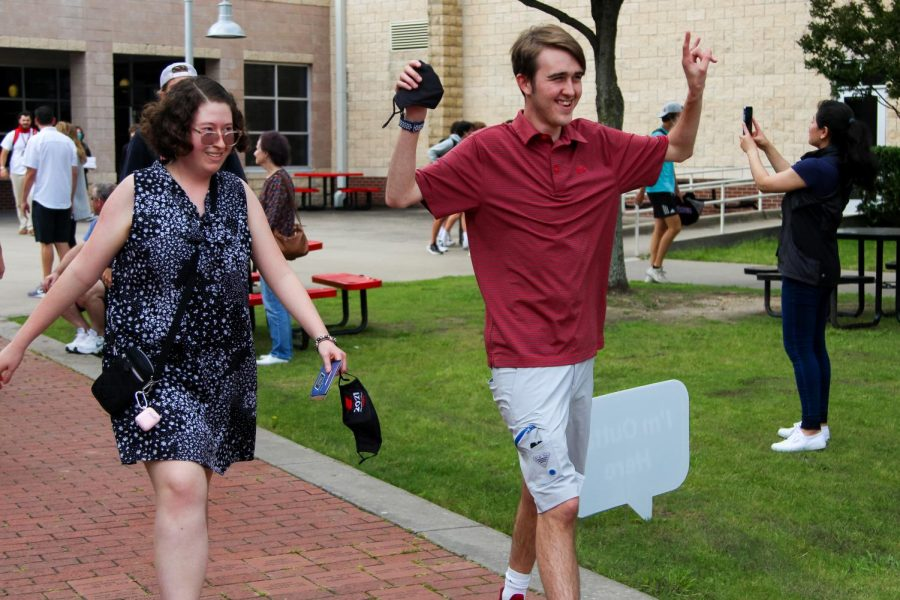 Senior Mackenzie Decarlo and John Michael Martin walk across the courtyard. Martin will be attending the University of North Texas.