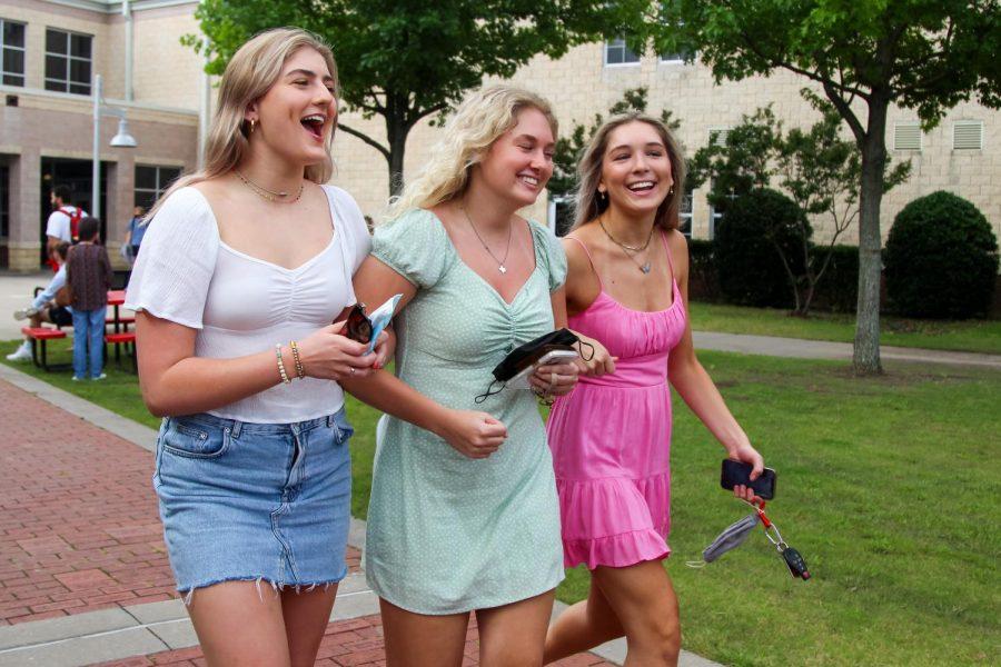 Seniors Libby Olsen and Ellie Jonke walk together on their last day. Jonke is attending the University of Oklahoma.