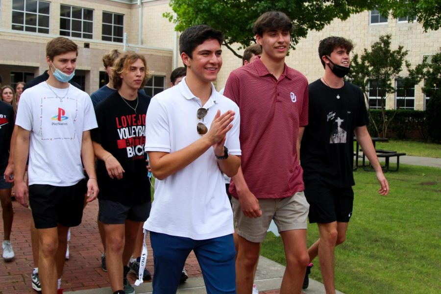 Senior Pony Starr walks along with friends through the courtyard. Starr graduated with the rest of the Class of 2021 today.