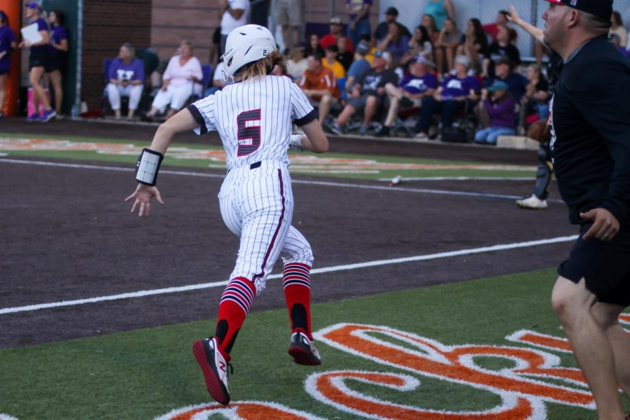 Freshman short stop no. 5 Skylar Rucker runs to home plate. Rucker scored the first run of the game for the Leopards.