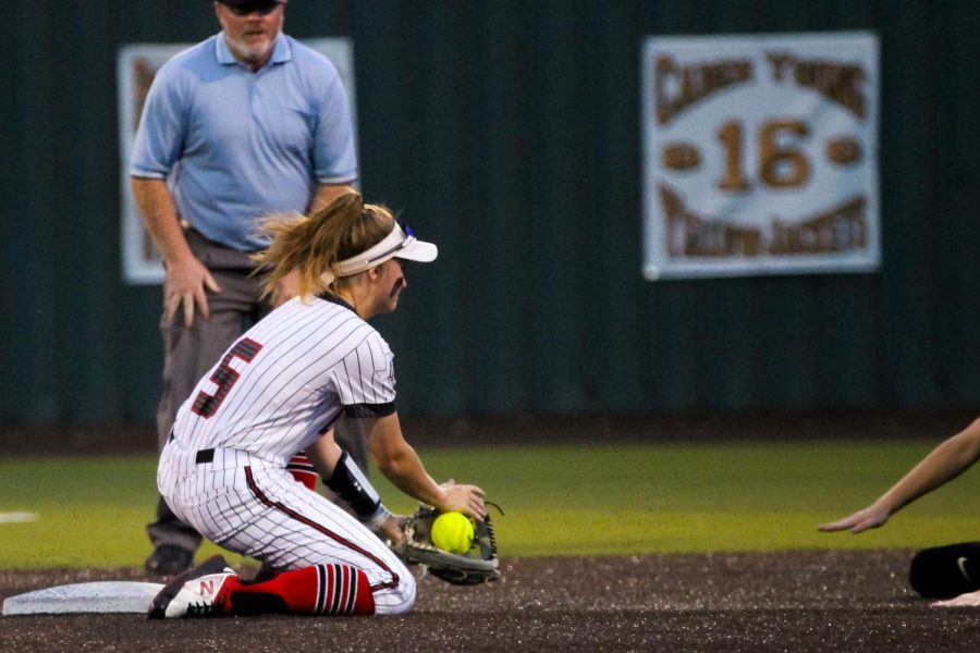 Freshman short stop no. 5 Skylar Rucker catches the ball. Rucker got the Wildcat player out in this play.