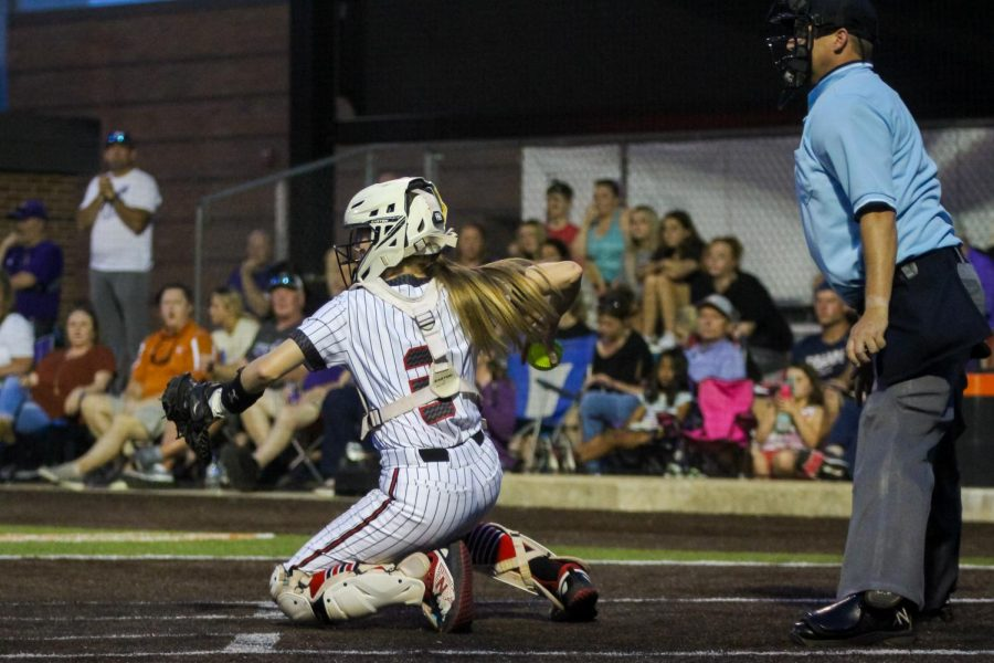 Sophomore catcher no. 3 Sydney Bardwell throws in to sophomore pitcher no. 7 Jade Owens. The Leopards finished their season in the regional finals.