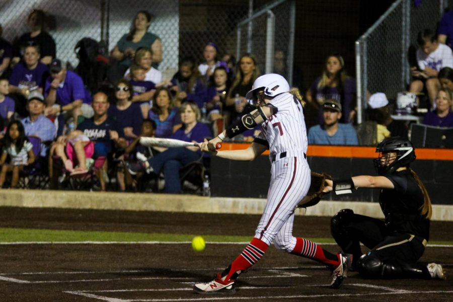 Sophomore pitcher no. 7 Jade Owens swings for the ball. Owens pitched four innings.