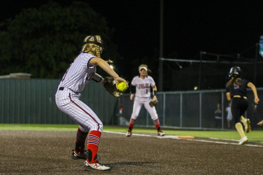 Sophore pitcher no. 7 Jade Owens throws to senior first baseman no. 4 Holly Massey. Massey got the runner out.