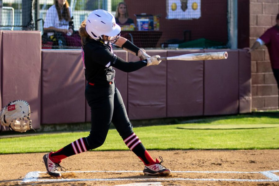 Sophomore second baseman no. 11 Hannah Harvey hits in the first inning. Freshmen shortstop no. 5 Skylar Rucker was the only player to score a run in the first inning.