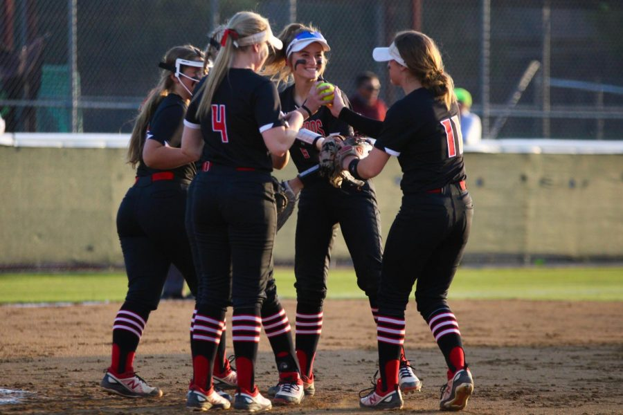 Infielders junior third baseman no. 16 Emma Bittlestone, sophomore pitcher no. 7 Jade Owens, senior first baseman no. 4 Holly Massey, freshmen shortstop no. 5 Skylar Rucker, and sophomore second baseman no. 11 Hannah Harvey celebrate after getting a Coyote player out. The Leopards won the second game with a final score of 5-4 after playing an 11 inning game.