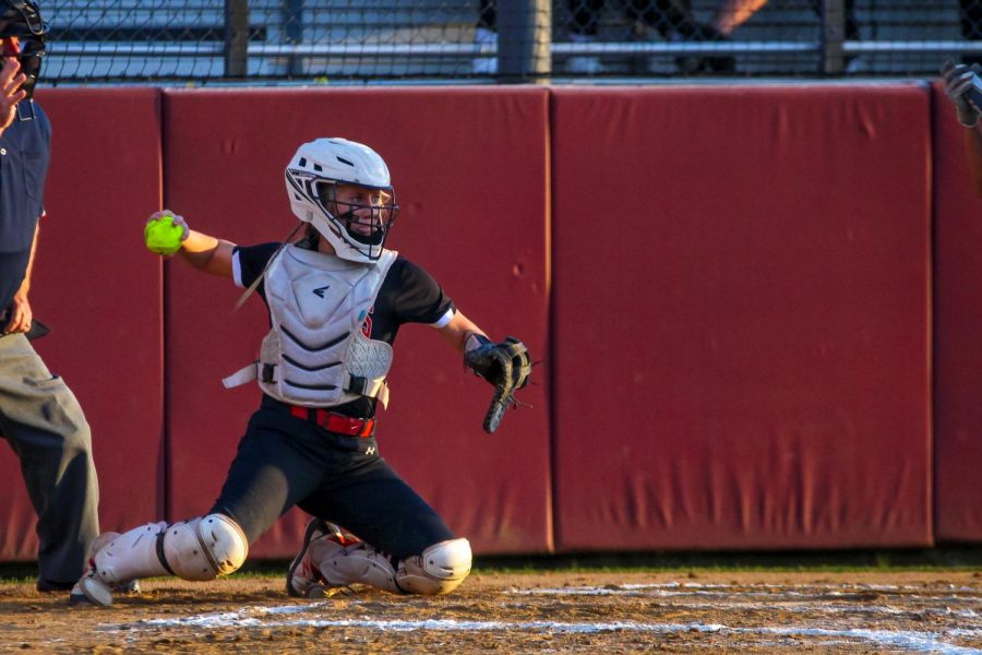 Sophomore catcher no. 3 Sydney Bardwell throws the ball back in to sophomore pitcher no. 7 Jade Owens. The Leopards allowed only two runs to be scored by the Coyotes.