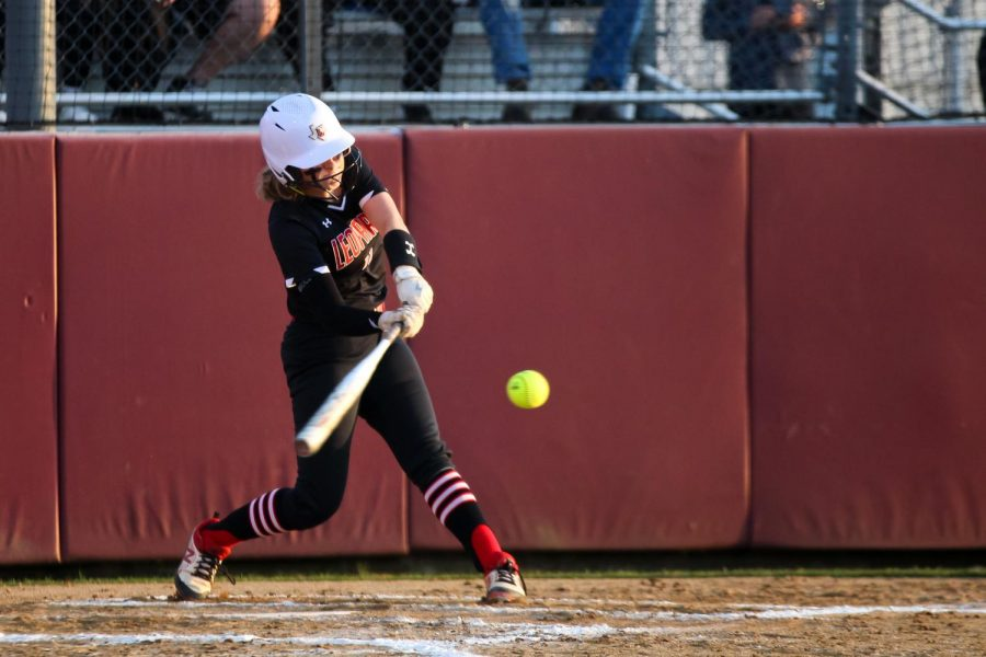 Sophomore second basemen no. 11 Hannah Harvey swings for the ball. The Leopards will play in Rockwall on Wednesday for their next game in the playoff season.